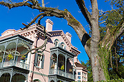 Traditional grand mansion house with lacy wrought iron fretwork in the Garden District of New Orleans, Louisiana, USA