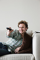 Man using remote control from sofa