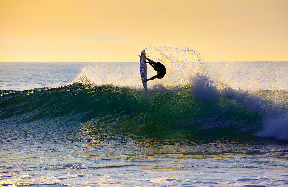 Brazilian Adriano De Souza performs an aerial during an early morning surf at Jeffrey's Bay, South Africa on 3 July 2015. De Souza leads the World Surf League Championship Tour Rankings and was one of the first of the professional competitors to arrive for the upcoming J-Bay Open held from July 8-19 2015