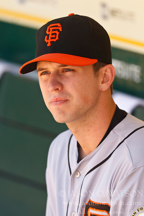 OAKLAND, CA - JUNE 24: Buster Posey #28 of the San Francisco Giants sits in the dugout before an interleague game against the Oakland Athletics at O.co Coliseum on June 24, 2012 in Oakland, California.  The Oakland Athletics defeated the San Francisco Giants 4-2. (Photo by Jason O. Watson/Getty Images) *** Local Caption *** Buster Posey