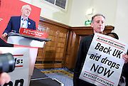 Jeremy Corbyn MP<br /> Human Rights speech and panel discussion <br /> Leader of the Labour Party <br /> arriving at Central Methodist Hall, Westminster, London, Great Britain <br /> 10th December 2016 <br /> <br /> Peter Tatchell protest<br /> <br /> <br /> Photograph by Elliott Franks <br /> Image licensed to Elliott Franks Photography Services