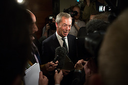 Ngel Farage deliver speech after significant gains. The leader of UKIP party Nigel Farage answer questions with journalist after giving  a party speech in central London after his significants gains in the European and Council elections. InterContinental Hotel, London, United Kingdom. Monday, 26th May 2014. Picture by Daniel Leal-Olivas / i-Images
