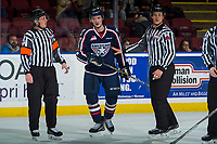 KELOWNA, CANADA - JANUARY 3: Carson Focht #17 of the Tri-City Americans stands on the ice between referee Ryan Okeeffe and linesman Dustin Minty at the Kelowna Rockets on January 3, 2017 at Prospera Place in Kelowna, British Columbia, Canada.  (Photo by Marissa Baecker/Shoot the Breeze)  *** Local Caption ***