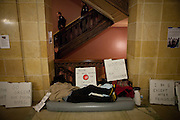 A protestor sleeps in the Wisconsin State Capitol over a bill that threatens to strip collective bargaining rights in Madison, Wisconsin, February 22, 2011.