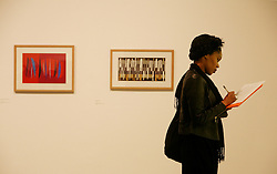 © Licensed to London News Pictures 16/04/2013.A woman takes notes during the press review of Slaoua Raouda Choucair's exhibition that is on display at the Tate Modern..London, UK.Photo credit: Anna Branthwaite/LNP