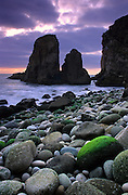 A rock covered with green algae is revealed during a low tide on Malhada do Ourical, near Cape Roca. This cape, which is part of the Sintra-Cascais natural park, is the westernost point of continental Europe.