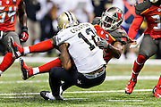 NEW ORLEANS, LA - SEPTEMBER 20:  Marques Colston #12 of the New Orleans Saints is tackled by Alterraun Verner #21 of the Tampa Bay Buccaneers at Mercedes-Benz Superdome on September 20, 2015 in New Orleans Louisiana. The Buccaneers defeated the Saints 26-19.   (Photo by Wesley Hitt/Getty Images) *** Local Caption *** Marques Colston; Alterraun Verner