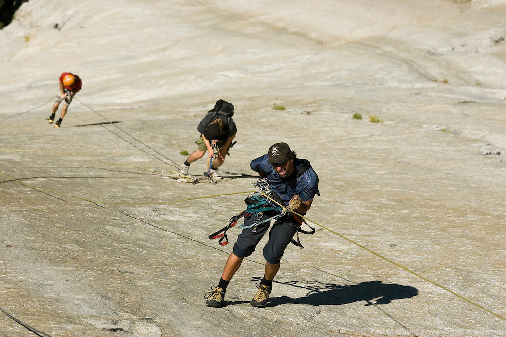 Thomas Huber rappels from the Nose after filming for Am Limit, a Lotus Film production, about the brothers Alex and Thomas's attempt to break the speed climbing record on the Nose of El Capitan in Yosemite National Park, California, USA.