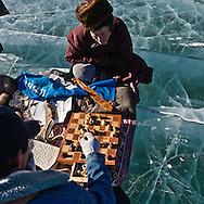 Mongolia. goods on sale, Ice festival on the frozen Khuvsgul lake. - siberia border - for the mongol new year ,  tsagaan sar, in the cold winter   Khuvsgul province -   /  marche, Festival des glaces sur le lac gelé de Khovsgol - frontiere siberienne-  pour Tsagan sar; le nouvel an mongol, en hivoir dans le froid   Khovgul  - Mongolie /  L0055880F