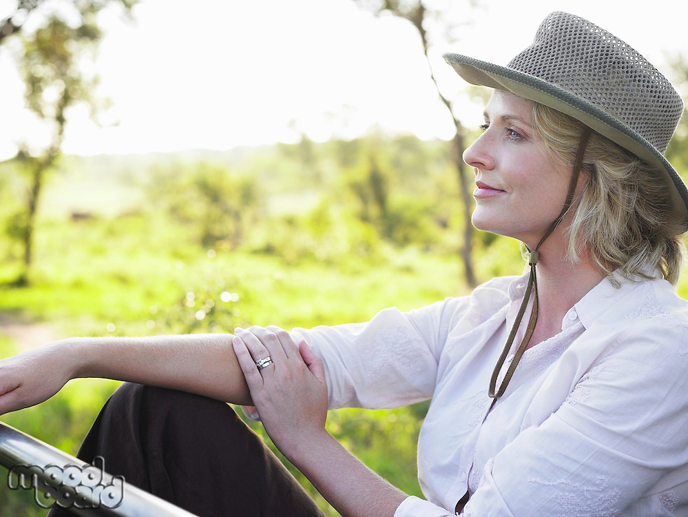 Portrait of adult woman sitting wearing hat thinking