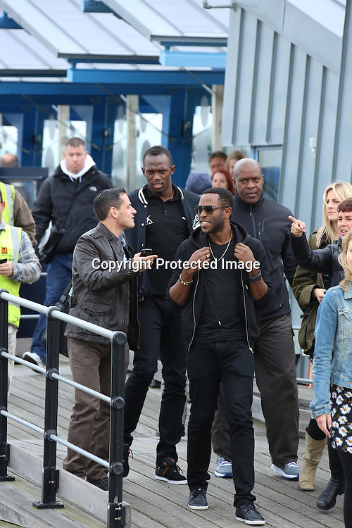 USSAIN BOLT ARRIVES ON SOUTHEND PIER LOOKING SLIGHTLY BEMUSED AND VERY COLD TO FILM WITH JAMIE OLIVER AND JIMMY DOCHERTY.20.9.13.PIX STEVE BUTLER