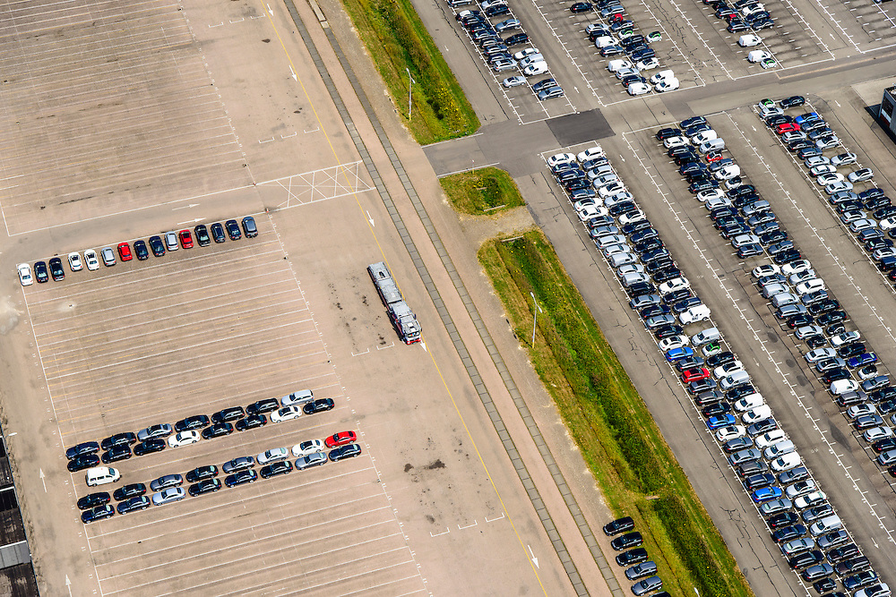 Nederland, Limburg, Gemeente Sittard-Geleen, 26-06-2014; Born, parkeerterrein Koopman Automotive Solutions, onder andere voor lease auto's.<br /> Parking Koopman Automotive Solutions, including company cars.<br /> luchtfoto (toeslag op standaard tarieven);<br /> aerial photo (additional fee required);<br /> copyright foto/photo Siebe Swart.