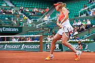 Paris, France - 2017 June 03: Alize Cornet from France  plays a backhand during women's single match third round  during tennis Grand Slam tournament The French Open 2017 (also called Roland Garros) at Stade Roland Garros on June 03, 2017 in Paris, France.<br /> <br /> Mandatory credit:<br /> Photo by © Adam Nurkiewicz<br /> <br /> Adam Nurkiewicz declares that he has no rights to the image of people at the photographs of his authorship.<br /> <br /> Picture also available in RAW (NEF) or TIFF format on special request.<br /> <br /> Any editorial, commercial or promotional use requires written permission from the author of image.