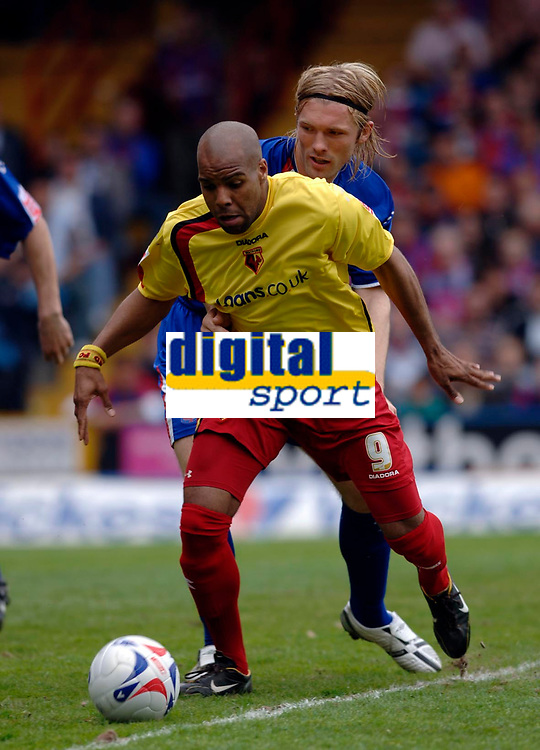 Photo: Daniel Hambury.<br />Crystal Palace v Watford. Coca Cola Championship. Play off Semi-Final, First Leg. 06/05/2006.<br />Watford's Marlon King beats Palace's Darren Ward as he scores the first goal.