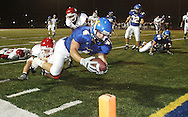 Hutchinson runningback Gage McKinnis dives for the endzone to score a touchdown against Maize at Gowans Stadium Friday, Sept. 28, 2007.