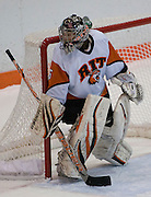 2012/03/04 - RIT goalie Laura Chamberlain watches the puck during the first period of the ECAC West Championship game between RIT and SUNY Plattsburgh at RIT's Ritter Arena on March 4th, 2012. RIT lead 1-0 after one period of play.
