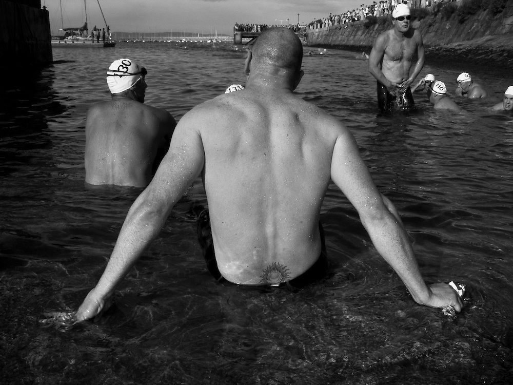 Exhausted competitors after at the finish of the 2005 Dun Laoghaire Harbour Swim, Dun Laoghaire, Co. Dublin, Ireland 2005.