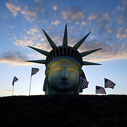 An inflated Statue of Liberty peers over Seattle's Gasworks Park on July 3, 2003.