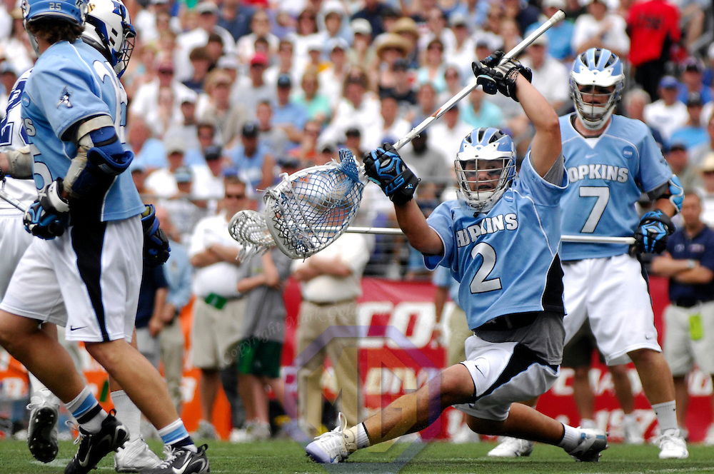 28 May 2007:  Johns Hopkins goal keeper Jesse Schwartzman (2) makes one of his 15 saves against Duke University mid fielder Mike Catalino (29) in the NCAA Division I Lacrosse Championship game.  Schwartzman was named the  Most Outstanding Player of the 2005 championship game as the Johns Hopkins Blue Jays defeated the Duke Blue Devils 12-11 to win the NCAA Division I Lacrosse championship at M&T Bank Stadium in Baltimore, Md. .