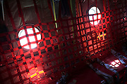 Red webbing inside a Lockheed Martin-built C-130J Hercules airlifter. Externally similar to the classic Hercules in general appearance, the J model sports considerably updated technology. These differences include new Rolls-Royce AE 2100 D3 turboprops with Dowty R391 composite scimitar propellers, digital avionics (including Head-Up Displays (HUDs) for each pilot). During more than 50 years of service the Hercules family has the longest continuous production run of any military aircraft in history. Strategic, automated low-level airdrops keep 60 road transport vehicles and up to 120 supple troops off hostile roads using only three flight crew.