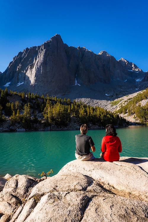 Hikers enjoying the view from Big Pine Lake #3, John Muir Wilderness, Sierra Nevada Mountains, California USA