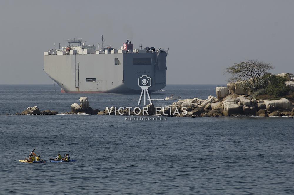 Cargo ship waiting on bay of Acapulco. Guerrero, Mexico