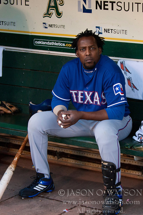 September 23, 2010; Oakland, CA, USA;  Texas Rangers designated hitter Vladimir Guerrero (27) in the dugout before the game against the Oakland Athletics at Oakland-Alameda County Coliseum.  Oakland defeated Texas 5-0.