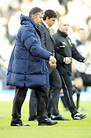 30/10/2004<br />FA Barclays Premiership - Fulham v Tottenham Hotspur - Craven Cottage, London<br />Tottenham Hotspur manager Jacques Santini walks off the pitch at the end of the match with Fulham manager Chris Coleman.<br />Photo:Jed Leicester/Back Page Images
