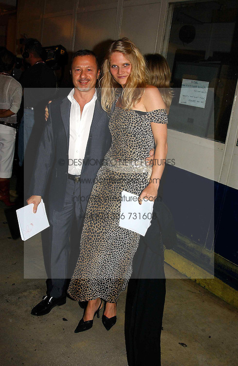 Fashion designer JACQUES AZAGURY and ARABELLA TOBIAS wife of actor Oliver Tobias at Fashion Fringe - part of London fashion week held at the Selfridges Car Park, off Oxford Street, London on 22nd September 2004.<br />