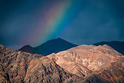 Rainbow over Death Valley National Park seen from Furnace Creek, California, USA.