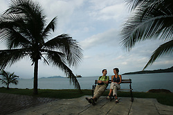 "A couple sits on a bench on the mile-long Causeway, which juts out between the canal and Panama Bay, as they walk to a ferry that will take them to nearby Taboga Island.  Panama is poised to become the ""next Costa Rica"", though tourists have yet to begin flocking to the central american country.  The Capital, Panama City, is home to the Panama Canal and, due to the former US military presence, is one of the continents capitals most comfortable for people from the United States.  The country offers a variety of eco-tourism opportunities as well as a capital that mixes a modern feel with a colonial center."
