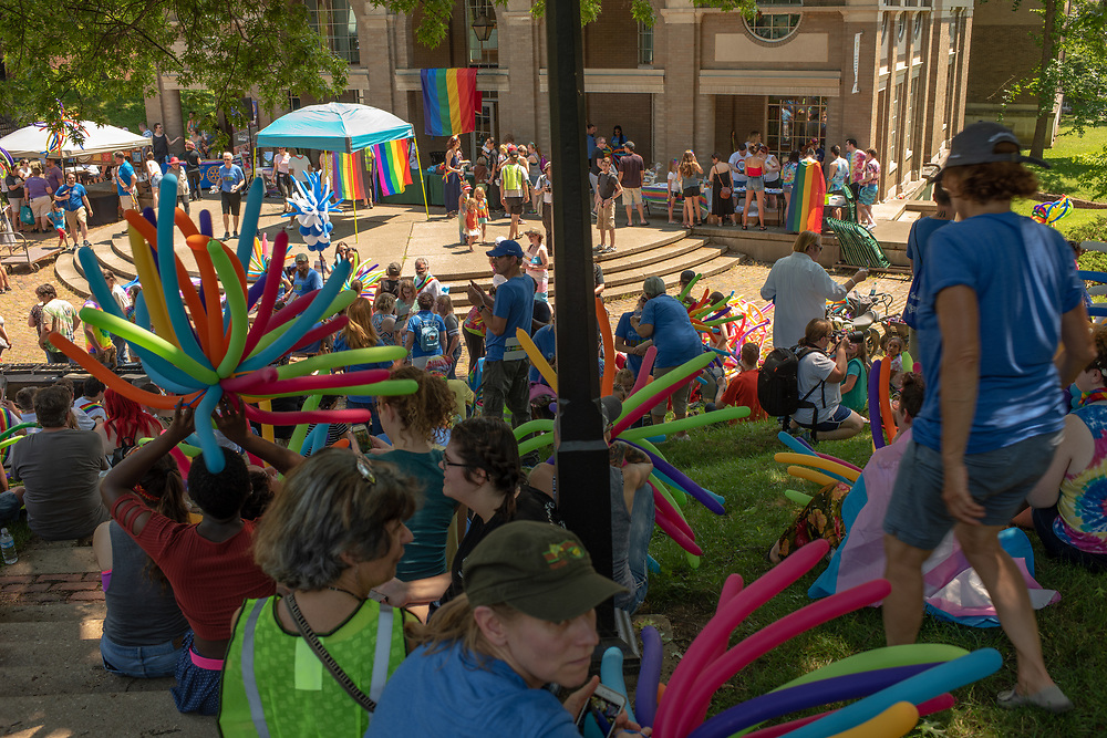 Athens Commnuity members gather to listen to speakers following the city's  first PRIDE PARADE. The parade is part of Athens Pride Fest, a  week long celebration of solidarity, diversity, unity, and activism. Photo by Ben Siegel