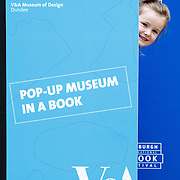 FREE PICTURES :   A pop-up museum in a book was launched today (Thursday 25 August) at the Edinburgh International Book Festival. Scarlett Wallace (4) from Edinburgh plays 'peek a boo' with the book.<br /> <br /> <br /> The pop-up version of V&A Museum of Design Dundee was created by designers Tessa Asquith-Lamb and Martin Baillie along with smaller kits for children to build their own pop-up museum.<br /> <br />  Both the large pop-up book and the design kits feature inspiring items of Scottish design, ranging from the Falkirk Wheel, the world's only rotating boat lift, to a Jaguar sports car and a traditional Orkney chair.<br /> <br />  Today's event in Edinburgh was the first in series of free family activities where the pop-up book and kits will be used to spark young people's interest in design, ahead of V&A Dundee opening in 2018.Picture Robert Perry 25th Aug 2016<br /> <br /> Please credit photo to Robert Perry<br /> <br /> Image is free to use in connection with the promotion of the above company or organisation. 'Permissions for ALL other uses need to be sought and payment make be required.<br /> <br /> <br /> Note to Editors:  This image is free to be used editorially in the promotion of the above company or organisation.  Without prejudice ALL other licences without prior consent will be deemed a breach of copyright under the 1988. Copyright Design and Patents Act  and will be subject to payment or legal action, where appropriate.<br /> www.robertperry.co.uk<br /> NB -This image is not to be distributed without the prior consent of the copyright holder.<br /> in using this image you agree to abide by terms and conditions as stated in this caption.<br /> All monies payable to Robert Perry<br /> <br /> (PLEASE DO NOT REMOVE THIS CAPTION)<br /> This image is intended for Editorial use (e.g. news). Any commercial or promotional use requires additional clearance. <br /> Copyright 2016 All rights protected.<br /> first use only<br /> contact details<br /> Rober