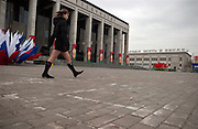 Emulating the marching steps of a Soviet-era soldier, a girl traverses Minsk's October Square, named after the Russian revolution of 1917, as banners in the colors of the Russian and Belarusian flags flap in the wind on the day Russian President Vladimir Putin is to visit the capital of the former Soviet republic on March 31, 2006. Belarus and, in particular, its President Alexander Lukashenko maintain close ties with their larger eastern neighbor, relying on energy-rich Russia for cheap oil and natural gas.