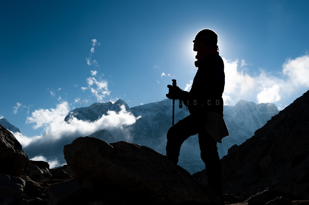 Silhouette of a trekker near the Khumbu Glacier, Nepal Himalaya. Photo © robertvansluis.com