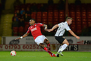 Swindon Town Forward, Jonathan Obika (9) beats Northampton Town Forward, Sam Hoskins (14) to the ball during the EFL Sky Bet League 1 match between Swindon Town and Northampton Town at the County Ground, Swindon, England on 27 September 2016. Photo by Adam Rivers.