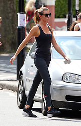 Model Abbey Clancy out and about in London, UK. 24/07/2014<br />BYLINE MUST READ : JAMESY/GOTCHA IMAGES<br /><br />Copyright by © Gotcha Images Ltd. All rights reserved.<br />Usage of this image is conditional upon the acceptance <br />of Gotcha Images Ltd, terms and conditions available at<br />www.gotchaimages.com
