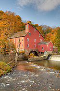The historic Red Mill at Clinton adorned in fall foliage.