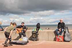 The Commonwealth Games Queen's Baton came to Portobello Beach and it still wasn't the biggest thing happening there. The Big Beach Busk, now in its eighth year was just getting underway when the Baton arrived at the beach volleyball courts by Portobello Baths where a Men's CEV Continental Tour competition was underway. Pictured:<br /> <br /> <br /> © Jon Davey/ EEm