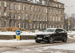 The Beast from the East, Storm Emma hit Edinburgh overnight and has left transport links decimated and many of the shops on the famous Princes Street closed for the day.<br /> <br /> Pictured: A 4x4 vehicle is able to negotiate the roundabouts in the New Town area of Edinburgh