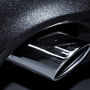 """""""Ford Mustang"""" mono<br /> <br /> A beautifully captured monochrome image of the exhaust tip of a 2013 Ford Mustang!!<br /> <br /> Cars and their Details by Rachel Cohen"""