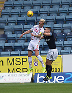 August 5th 2017, Dens Park, Dundee, Scotland; Scottish Premiership; Dundee versus Ross County; Ross County's Andrew Davies beats Dundee's Darren O'Dea in the air