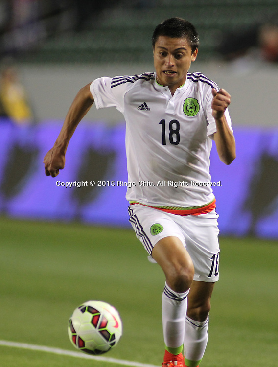 Mexico's Rosario Enrique Cota Carrazco #18 actions against United States during a men's national team international friendly match, April 22, 2015, at StubHub Center in Carson, California. United States won 3-0. (Photo by Ringo Chiu/PHOTOFORMULA.com)