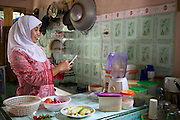 In 2007 Iin Hartini  started her own business selling Nasi Goreng (fried rice). <br /> <br /> She makes it in bulk for the school canteen to sell to children who have their breakfast at school. <br /> <br /> Prior to signing up to Usaha Wanita Iin had been beginning to feel demotivated about her work and for a short time ceased making the rice. Since receiving the advice and mentoring she has become reenergised for her business and her profits have tripled.