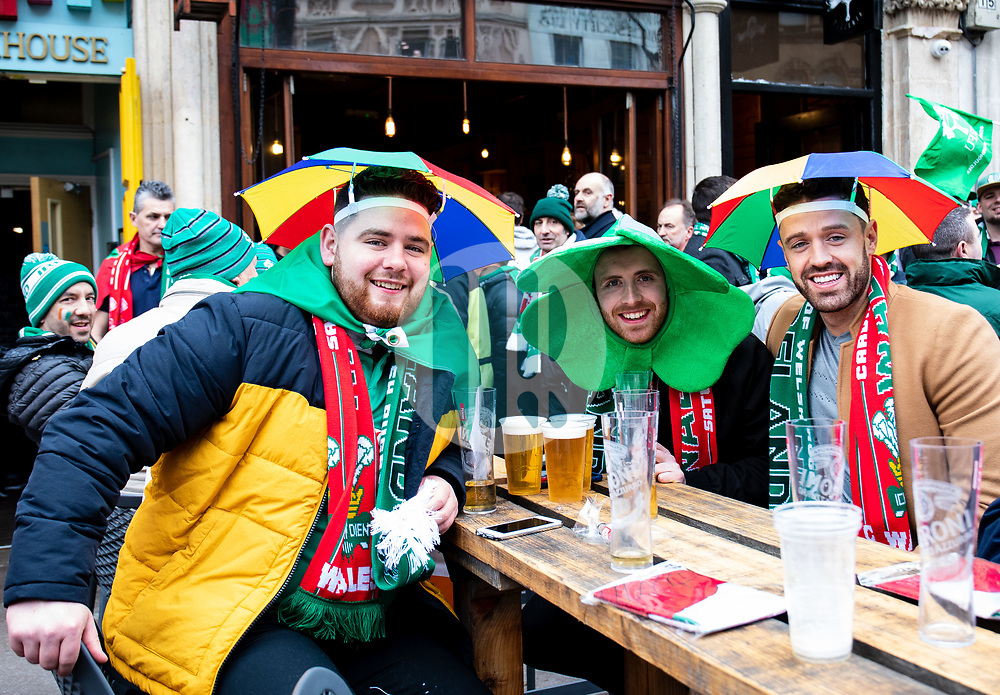 Ireland fans enjoy a pint<br /> <br /> Photographer Simon King/Replay Images<br /> <br /> Six Nations Round 5 - Wales v Ireland - Saturday 16th March 2019 - Principality Stadium - Cardiff<br /> <br /> World Copyright © Replay Images . All rights reserved. info@replayimages.co.uk - http://replayimages.co.uk