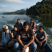 A group of honey hunters ride a boat at Pedu lake. They are camping at the side of Pedu lake for two weeks, hunting the honey during year 2016 harvesting season.