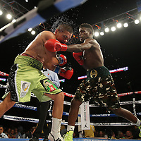 """Welterweight fighter Erickson """"Hammer"""" Lubin (right) fights against Noe Bolanos during the """"Judgement Day"""" boxing event at American Airlines Arena on Thursday, July 10, 2014 in Miami, Florida.  (AP Photo/Alex Menendez)"""