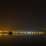 Looking towards the Pandora Pond and the main fishing harbour part of Ahuriri Estuary from the Motorway. Reflections of the lights on the water. Ahuriri Estuary, Napier, New Zealand. September.