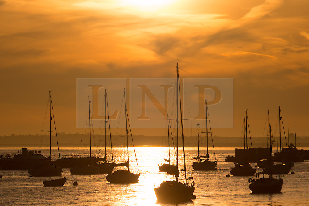 © Licensed to London News Pictures. 14/04/2015.  Sun rises over Gravesend Sailing Club. Several days of good weather are predicted and Gravesend is often the location where the highest temperatures are recorded. Credit : Rob Powell/LNP