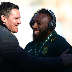 Tendai Mtawarira of South Africa hugs former team mate Jean de Villiers rugby commentator during the 2018 Castle Lager Incoming Series 2nd Test match between South Africa and England at the Toyota Stadium.Bloemfontein,South Africa. 16,06,2018 Photo by (Steve Haag JMP)